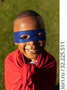 Купить «Superhero boy in garden», фото № 32225511, снято 6 сентября 2019 г. (c) Wavebreak Media / Фотобанк Лори