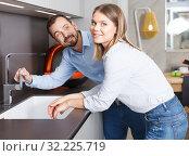 Купить «Couple engaged in household chores», фото № 32225719, снято 24 мая 2018 г. (c) Яков Филимонов / Фотобанк Лори