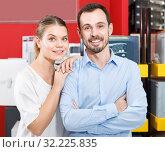 Купить «Young loving couple standing in specialty workshop of safes», фото № 32225835, снято 17 апреля 2018 г. (c) Яков Филимонов / Фотобанк Лори