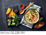 Купить «creamy broccoli cheddar cheese soup in a pot», фото № 32228191, снято 19 апреля 2019 г. (c) Oksana Zh / Фотобанк Лори