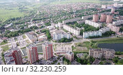 Купить «Aerial view of modern residential areas of Chekhov city in sunny spring day, Russia», видеоролик № 32230259, снято 13 мая 2019 г. (c) Яков Филимонов / Фотобанк Лори