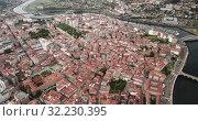 Купить «Aerial view of Pontevedra cityscape with a modern apartment buildings and sea bay, Spain», видеоролик № 32230395, снято 18 июня 2019 г. (c) Яков Филимонов / Фотобанк Лори