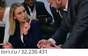 Купить «Group of formal dressed businesspeople discussing ideas in the office», видеоролик № 32230431, снято 10 мая 2017 г. (c) Vasily Alexandrovich Gronskiy / Фотобанк Лори