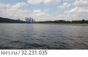 Купить «Landscape with a river and complex of skyscrapers in Moscow, Russia», видеоролик № 32231035, снято 28 сентября 2019 г. (c) Володина Ольга / Фотобанк Лори