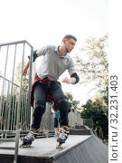 Купить «Roller skating, young skater rolling off the ramp», фото № 32231403, снято 5 июня 2019 г. (c) Tryapitsyn Sergiy / Фотобанк Лори
