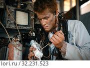 Купить «Crazy scientist works with electricity in lab», фото № 32231523, снято 17 июня 2019 г. (c) Tryapitsyn Sergiy / Фотобанк Лори
