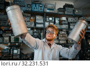 Купить «Scientist holds radiation devices in his hands», фото № 32231531, снято 17 июня 2019 г. (c) Tryapitsyn Sergiy / Фотобанк Лори