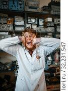 Купить «Strange scientist has gone mad in his laboratory», фото № 32231547, снято 17 июня 2019 г. (c) Tryapitsyn Sergiy / Фотобанк Лори
