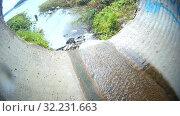 Купить «Ливневая городская канализация (ливневка). Сточные воды», видеоролик № 32231663, снято 13 января 2013 г. (c) Mikhail Erguine / Фотобанк Лори
