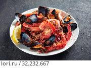 Купить «close-up of a mix a seafood on plate», фото № 32232667, снято 18 мая 2019 г. (c) Oksana Zh / Фотобанк Лори