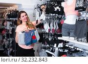 Купить «Female is choosing sports underwear», фото № 32232843, снято 20 марта 2017 г. (c) Яков Филимонов / Фотобанк Лори