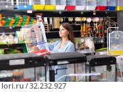 Купить «woman customer is looking a cage for canary bird», фото № 32232927, снято 22 октября 2019 г. (c) Яков Филимонов / Фотобанк Лори