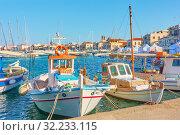 Купить «Old fishing boats in the port of Aegina», фото № 32233115, снято 14 сентября 2019 г. (c) Роман Сигаев / Фотобанк Лори