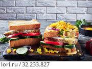 Купить «close-up of tasty homemade sandwiches with ham», фото № 32233827, снято 30 мая 2019 г. (c) Oksana Zh / Фотобанк Лори