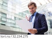 Купить «Professional man in jacket walking with coffee», фото № 32234275, снято 29 апреля 2017 г. (c) Яков Филимонов / Фотобанк Лори