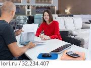 Купить «Consultant helping woman choosing upholstery fabric», фото № 32234407, снято 29 октября 2018 г. (c) Яков Филимонов / Фотобанк Лори