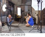 Купить «Photographer shooting female model on city street», фото № 32234519, снято 5 октября 2018 г. (c) Яков Филимонов / Фотобанк Лори