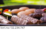 Купить «barbecue kebab meat and vegetables on grill», видеоролик № 32234747, снято 20 сентября 2019 г. (c) Syda Productions / Фотобанк Лори