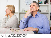 Husband and wife arguing with each other and try to resolve family conflict at table. Стоковое фото, фотограф Яков Филимонов / Фотобанк Лори