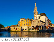 Old historical buildings and Lemene river in Portogruaro, Venezia (2019 год). Стоковое фото, фотограф Яков Филимонов / Фотобанк Лори