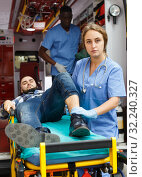Paramedic team providing first aid to man. Стоковое фото, фотограф Яков Филимонов / Фотобанк Лори