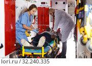 Купить «Ambulance team providing medical care to patient», фото № 32240335, снято 30 ноября 2018 г. (c) Яков Филимонов / Фотобанк Лори