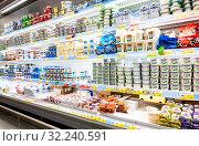 Купить «Fresh dairy products ready for sale in supermarket», фото № 32240591, снято 29 июня 2018 г. (c) FotograFF / Фотобанк Лори