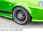 Купить «Modern automotive wheel on light alloy disc», фото № 32240691, снято 19 мая 2018 г. (c) FotograFF / Фотобанк Лори