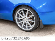 Купить «Modern automotive wheel on light alloy disc», фото № 32240695, снято 19 мая 2018 г. (c) FotograFF / Фотобанк Лори
