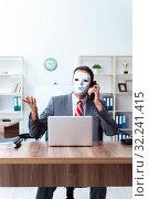 Купить «Businessman wearing mask in hypocrisy concept», фото № 32241415, снято 24 июня 2019 г. (c) Elnur / Фотобанк Лори