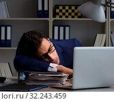 Купить «Businessman tired and sleeping in the office after overtime hour», фото № 32243459, снято 21 декабря 2017 г. (c) Elnur / Фотобанк Лори
