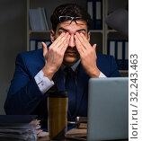 Купить «The businessman tired and sleeping in the office after overtime», фото № 32243463, снято 21 декабря 2017 г. (c) Elnur / Фотобанк Лори