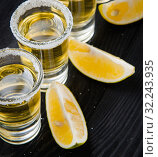 Купить «Tequila drink served in glasses with lime and salt», фото № 32243935, снято 18 сентября 2017 г. (c) Elnur / Фотобанк Лори