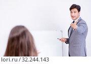 Купить «The business presentation in the office with man and woman», фото № 32244143, снято 7 августа 2017 г. (c) Elnur / Фотобанк Лори