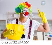 Купить «Funny clown doing cleaning at home», фото № 32244551, снято 12 мая 2017 г. (c) Elnur / Фотобанк Лори