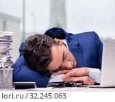Купить «Workaholic businessman overworked with too much work in office», фото № 32245063, снято 11 октября 2016 г. (c) Elnur / Фотобанк Лори