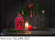 wooden lantern with candles and Christmas branchs on wooden background. Стоковое фото, фотограф Майя Крученкова / Фотобанк Лори