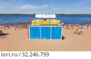 Купить «Russia, Samara, July 2016: Rescue post on the beach, people are sunning on a sandy beach on the Volga shore on a summer day. Text in Russian: Dear holidaymakers, the mode of operation of the rescue post.», фото № 32246799, снято 8 июля 2016 г. (c) Акиньшин Владимир / Фотобанк Лори