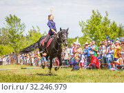 "Купить «Russia, Samara, June 2016: a demonstration of a Cossack girl on horseback for guests and spectators of the ""Journey to the Past"" festival, which is taking place near Samarah on Sunny Summer Day.», фото № 32246979, снято 18 июня 2016 г. (c) Акиньшин Владимир / Фотобанк Лори"
