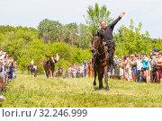 Купить «Russia, Samara, July 2016: Cossack performs tricks on a galloping horse», фото № 32246999, снято 18 июня 2016 г. (c) Акиньшин Владимир / Фотобанк Лори