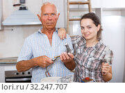 Enthusiastic female with elderly father during repairs. Стоковое фото, фотограф Яков Филимонов / Фотобанк Лори