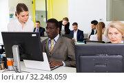 Купить «Business people working in coworking space», фото № 32248059, снято 10 марта 2018 г. (c) Яков Филимонов / Фотобанк Лори
