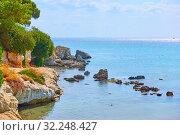 Купить «Beach on the seashore of Aegina Island», фото № 32248427, снято 13 сентября 2019 г. (c) Роман Сигаев / Фотобанк Лори