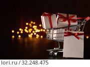 Купить «Gift boxes on shopping trolley.», фото № 32248475, снято 10 октября 2018 г. (c) Мельников Дмитрий / Фотобанк Лори