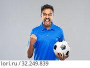 Купить «football fan with soccer ball celebrating victory», фото № 32249839, снято 8 сентября 2019 г. (c) Syda Productions / Фотобанк Лори