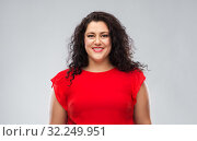 Купить «happy woman in red dress over grey background», фото № 32249951, снято 15 сентября 2019 г. (c) Syda Productions / Фотобанк Лори