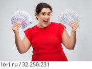 Купить «happy woman holding thousands of money banknotes», фото № 32250231, снято 15 сентября 2019 г. (c) Syda Productions / Фотобанк Лори