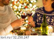 Купить «happy couple drinking red wine at christmas dinner», фото № 32250247, снято 17 декабря 2017 г. (c) Syda Productions / Фотобанк Лори