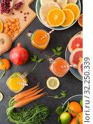 Купить «mason jar glasses of vegetable juices on table», фото № 32250339, снято 5 апреля 2018 г. (c) Syda Productions / Фотобанк Лори