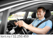 Купить «smiling man or driver driving car», фото № 32250459, снято 25 августа 2019 г. (c) Syda Productions / Фотобанк Лори